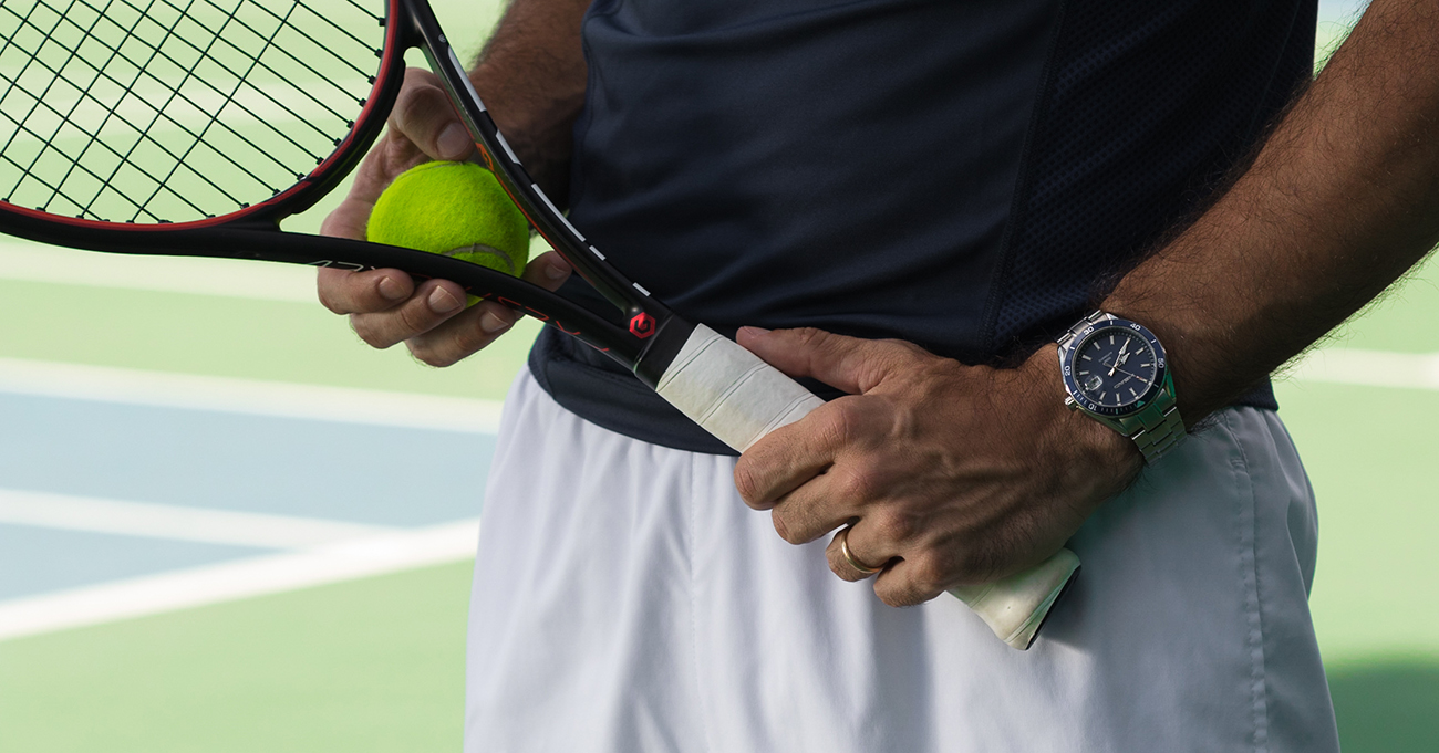 A tennis player with a HEAD watch